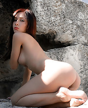 Hottie posing in a cave